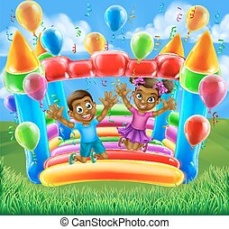 Children on Bouncy Castle - A happy boy and girl bouncing on...