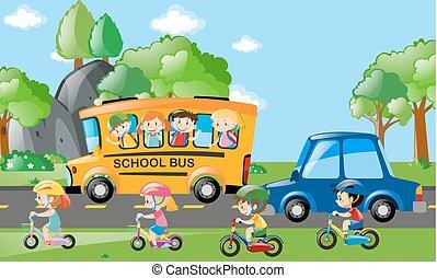 Children on bus and bike