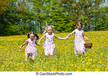 Children on Easter egg hunt with baskets - Children on an ...