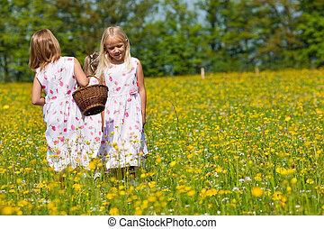 Children on Easter egg hunt with baskets