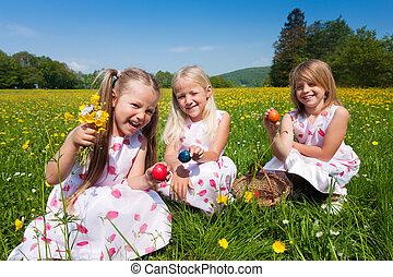 Children on Easter egg hunt with eggs - Children on an ...