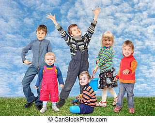 children on grass meadow and sky collage
