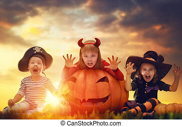 children on Halloween - Happy brother and two sisters on...