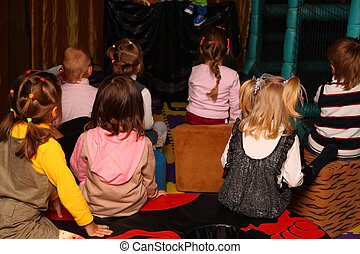 Children on holiday in kindergarten from back