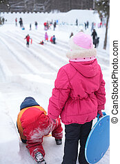 Children on ice slope in park