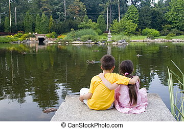 children on lake
