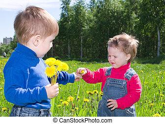 children on meadow dandelion .