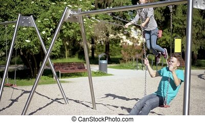 Children on swings at playground