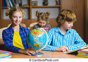 children on the geography lesson in school classroom. Educational concept