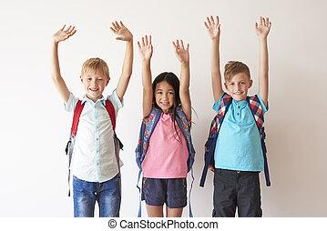 Children on white bakcground with hands up