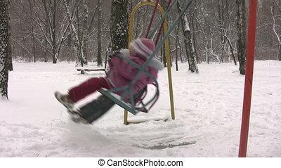children on winter seesaw