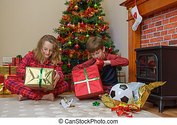 Children opening gifts on Christmas morning
