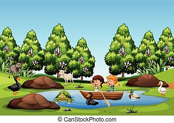 Children paddle boat in the lake