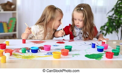 Children paint with gouache.