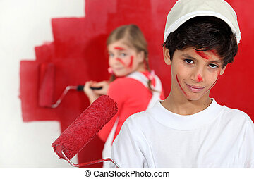 Children painting a room red
