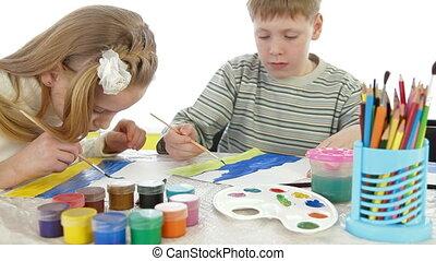 Children painting at art school education