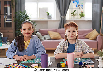 Children painting at the table