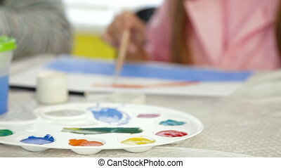 Children painting in art class