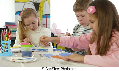 Children painting in playroom