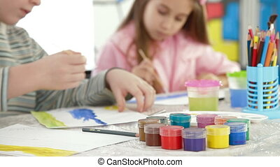 Children painting in watercolor