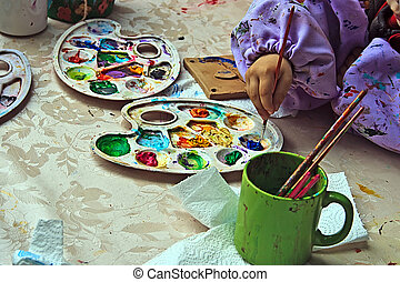 Children painting pottery at a workshop organized by the International Children's Day in Timisoara, Romania.