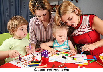 children painting with his mothers 2
