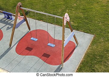 children park swing green grass high view rubber red soil