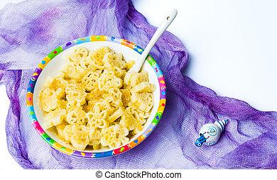 Children pasta in colorful bowl tabletop