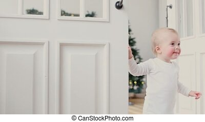 Children peeking out of the open room door