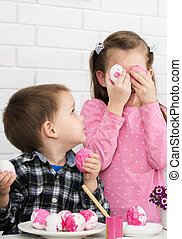 Children play decorated Easter eggs