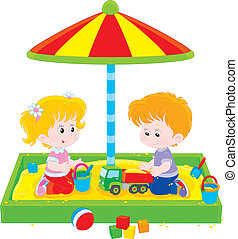 Children play in a sandbox - Little girl and boy playing in...