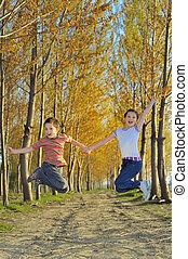 children play in forest