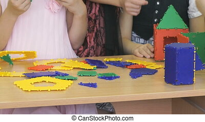 Children play in kindergarten indoors. Close-up of hands of...