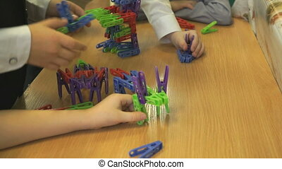 Children play in kindergarten indoors. Little boys...