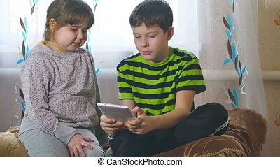 children play in Tablet