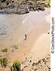 Children play in the beach