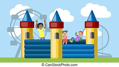 Children play in the bouncy castle in amusement park -...