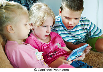 Children play on game console - Children play on the ...