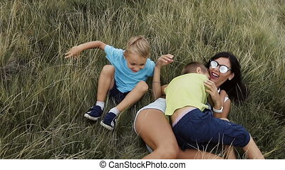 Children play with my mom in the mountains a fun family