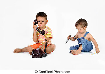 children play with old phone
