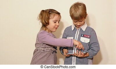 children play with tablet
