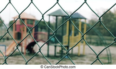 Children playground agains fence