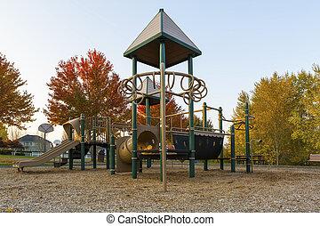 Children Playground in Neighborhood Park in Fall Season