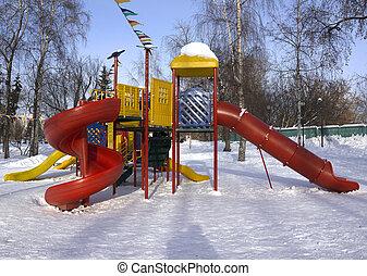 Children playground in winter
