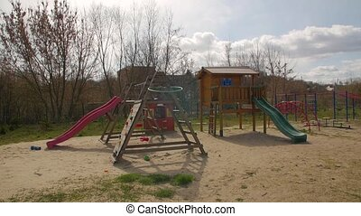 Children playground outdoors empty in quarantine autumn first snow falls camera movement