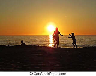 Children Playing at Sand Beach Seaside during Sunset with Clouds