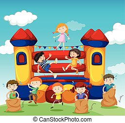 Children playing at the bouncing house