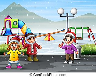 Children playing at the snowy playground