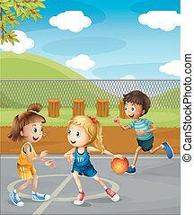 Children playing basketball at the court