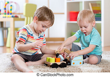 Children playing car toy in nursery or daycare